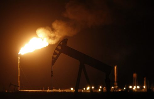 Oil ends lower amid global output uncertainty; U.S. supplies dip