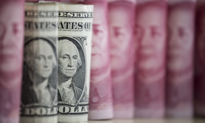 Dollar adds to slide as trade fears are back at center stage