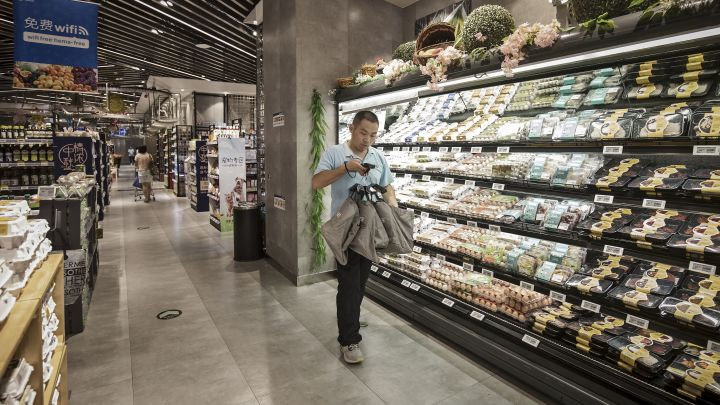 Inside Alibaba's new kind of superstore: Robots, apps and overhead conveyor belts