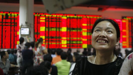 Chinese investors expect a turnaround in the beaten-down stock market, survey shows
