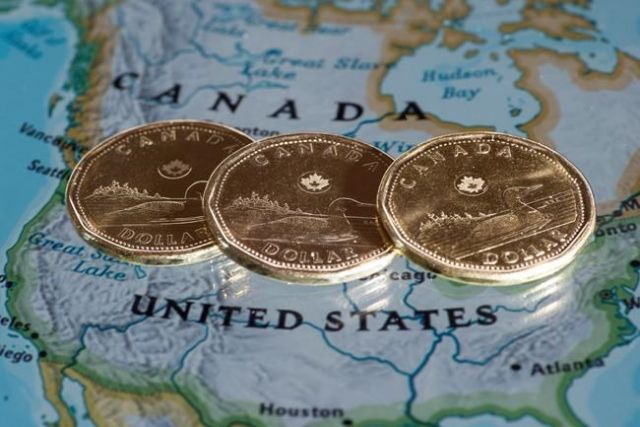 Loonie soars on trade deal