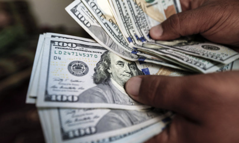 Dollar slides; euro finds footing as EU softens Italy criticism