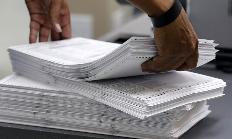 Lawsuits, accusations fly as Florida begins arduous recount process