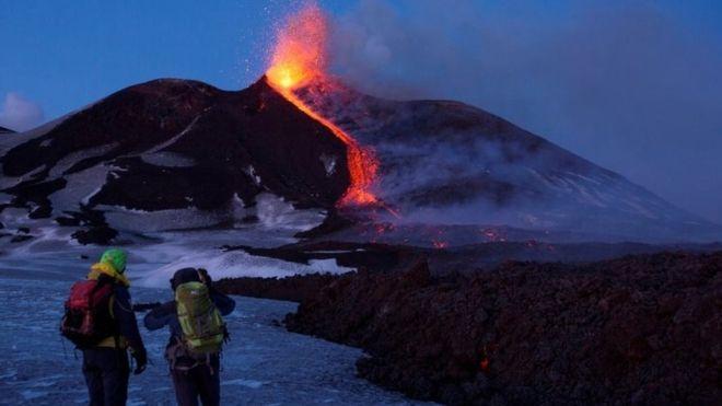 Mount Etna erupts in Sicily amid dozens of tremors