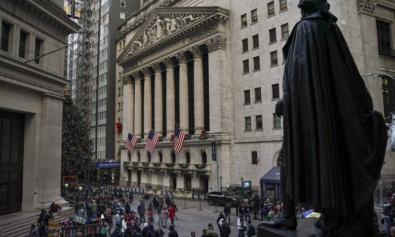 Stocks end mostly lower but log first weekly gain in a turbulent December