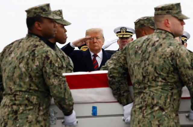 Trump salutes remains
