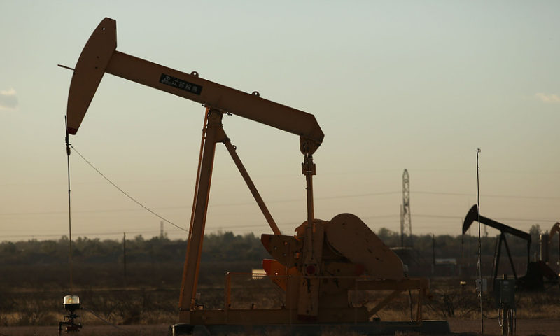 Oil posts a gain with OPEC output at its lowest in nearly 4 years