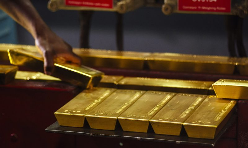 Gold drops, ending nine day rally