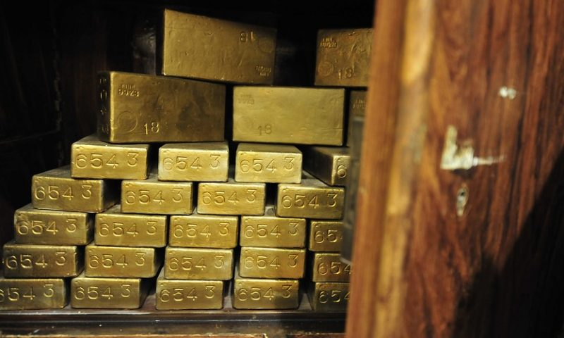 What's driving the rare simultaneous rise in gold and the dollar
