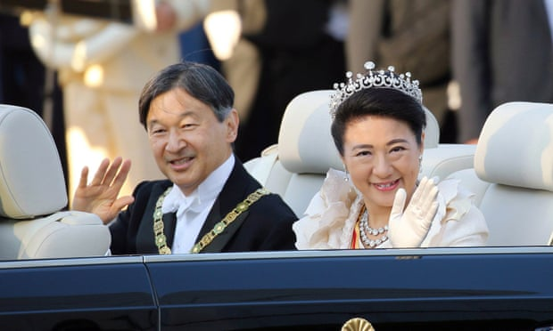 Japan's new emperor greeted by thousands during rare parade
