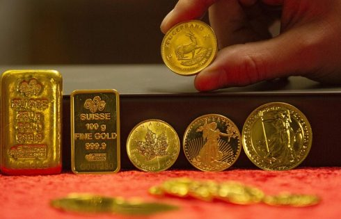 Gold prices settle higher, then seesaw as Fed stands pat on interest rates