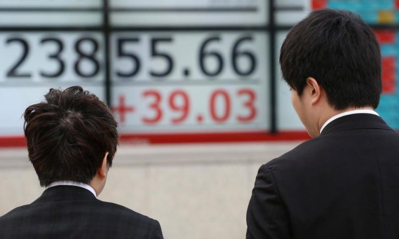 World Shares Mostly Lower in Quiet Pre-Christmas Trading