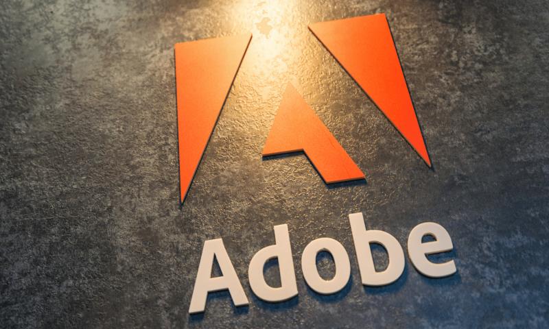 Wells Fargo & Co Lowers Adobe (NASDAQ:ADBE) Price Target to $315.00