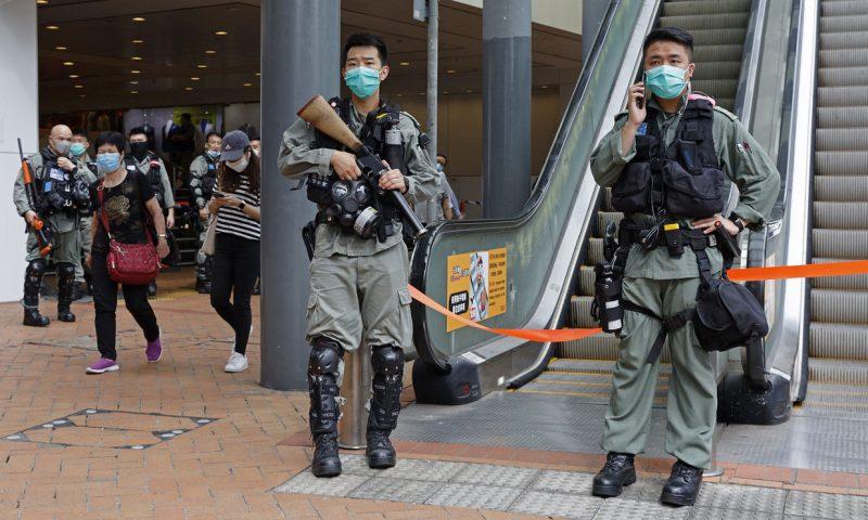 Asian markets mixed as tensions flare in Hong Kong
