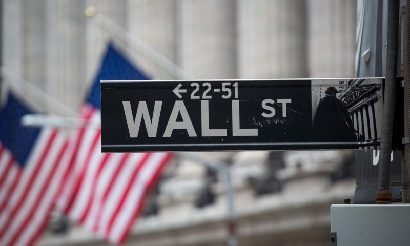 Dow, S&P 500 finish lower but Nasdaq books a gain ahead of parade of earnings from megacap tech-related firms