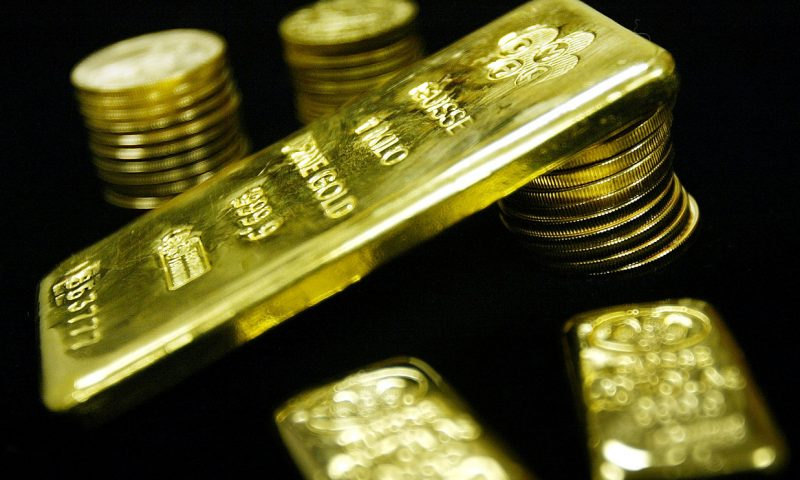 Gold ends at a nearly 1-week high as U.S. dollar softens to start July's first full week