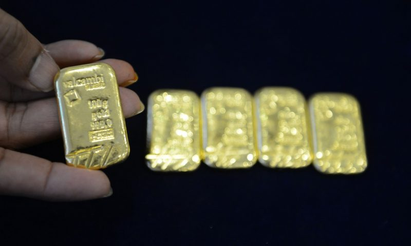 Gold prices drop nearly 3% as rise in coronavirus cases sparks dollar rally