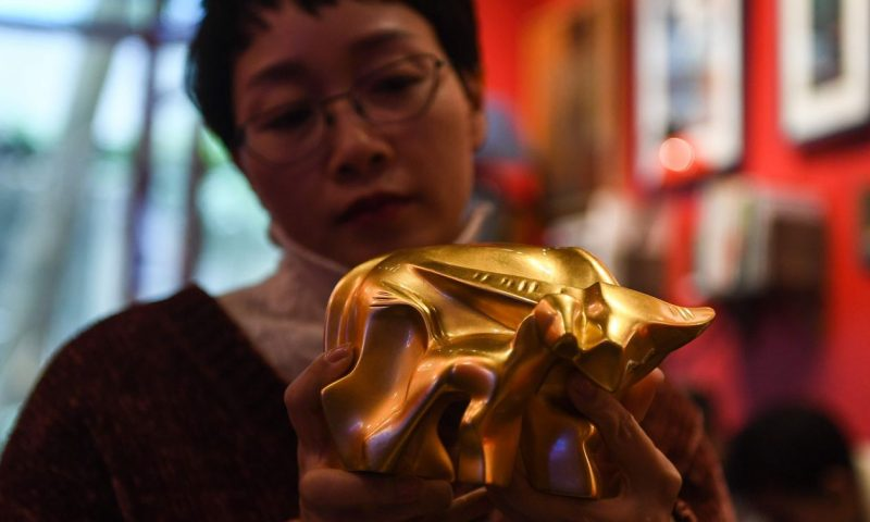 Gold bounces back from lowest close since early December as dollar slips