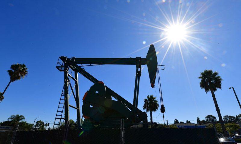 Oil prices settle higher on stimulus hopes, weaker dollar